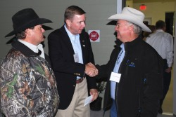 John Arthington, director of the University of Florida's Range Cattle Research and Education Center, shakes hands with Cliff Coddington, of Bradenton, at last week's opening of the Grazinglands Education Building at the research center in Ona. Coddington is also the Manatee County Cattlemen's state director and the chairman of the Florida Beef Council. To Arthingon's right is Steve John, a longtime Manatee County and Florida Cattlemen's Association member from Myakka City.   Credit:  Jim Handley, Florida Beef Council