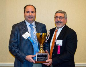 Kent Fountain, left, received the loving cup from incoming NCGA President Ron Craft on being named the 2016 Horace Hayden Ginner of the Year.